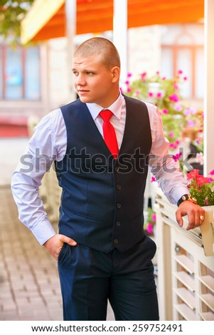 Handsome groom at wedding tuxedo smiling and waiting for bride. Happy smiling groom newlywed. Rich groom at wedding day.  - stock photo