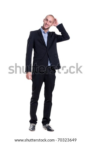 handsome groom scratching his head - stock photo