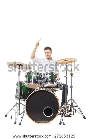 Handsome guy behind the drum kit on a white background in shirt and trousers - stock photo