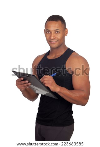 Handsome guy filling the form of the gym isolated on white background - stock photo
