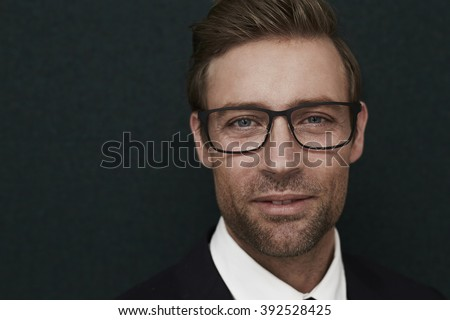 Handsome guy in suit and spectacles, portrait - stock photo