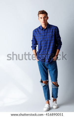 Handsome guy is evincing his sexuality - stock photo