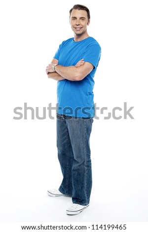 Handsome guy keeping his arms crossed, casual shot on white background - stock photo