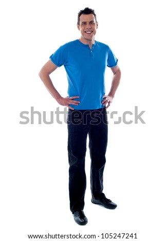 Handsome guy posing with hands on his waist wearing casuals - stock photo