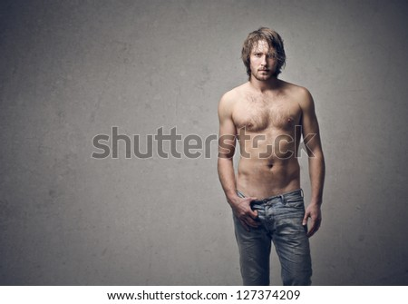 handsome guy shirtless on a gray background - stock photo