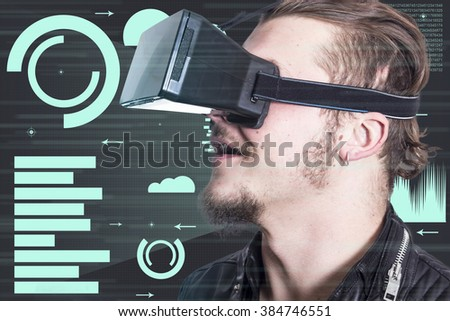Handsome guy using VR glasses
