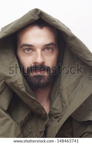 Handsome guy with beard and arab clothing on white background