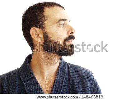 Handsome guy with beard and japanese jacket on white background