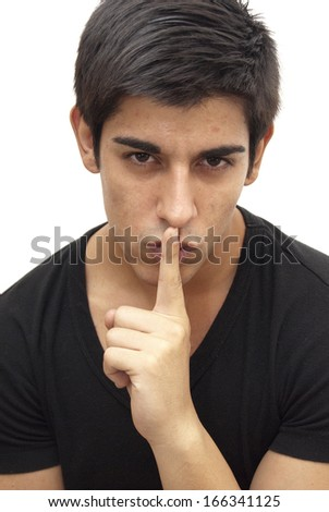 Handsome guy with black shirt commanding silence on white background