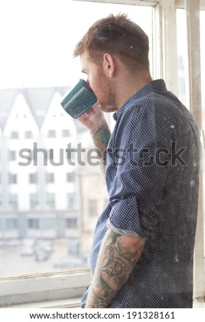 Handsome guy with cup of tea