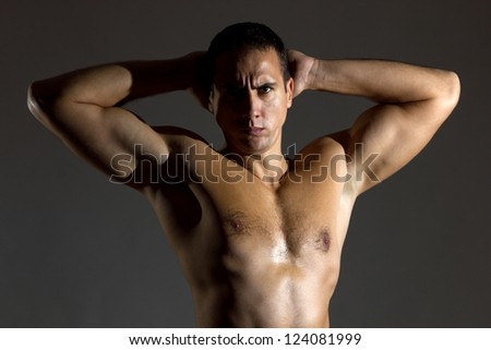 Handsome guy with naked torso - stock photo