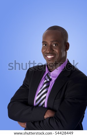 Handsome happy African American corporate business man smiling, wearing black suit with purple shirt, arms crossed,  isolated. - stock photo