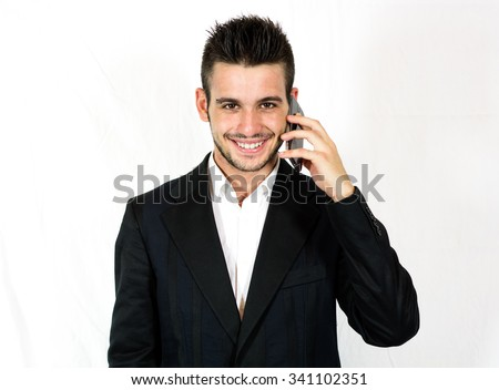 Handsome happy business calling with his smartphone against white background - Caucaisna people - stock photo