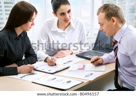 Handsome happy business man with colleagues - stock photo