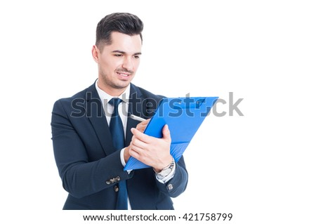 Handsome happy businessman or banker taking notes on clipboard as paperwork concept isolated on white - stock photo