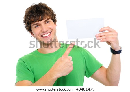 Handsome happy man showing on by finger on blank card - stock photo