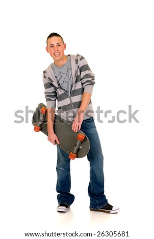 Handsome happy smiling blushing skater-boy dressed in jeans, studio shot - stock photo