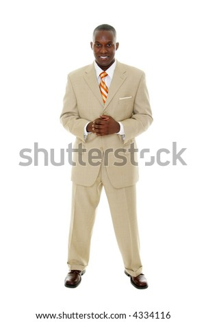 Handsome happy smiling man in tan business suit standing with hands clasped together. - stock photo