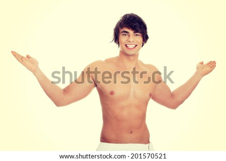 Handsome, happy young man with the towel around his waist. - stock photo