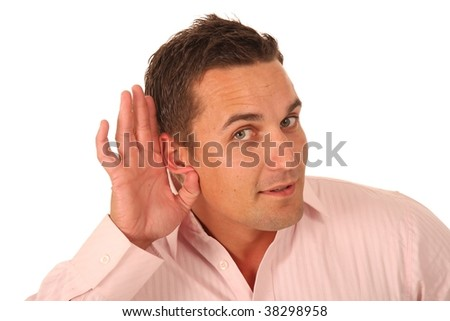 Handsome hard of hearing young man with hand to ear