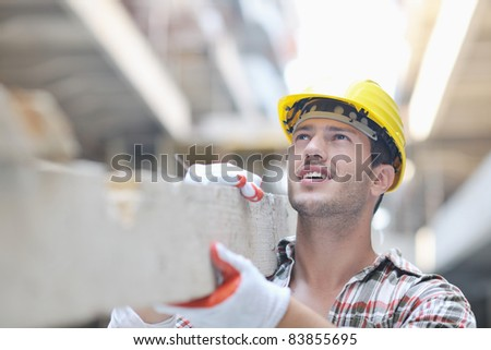 handsome hard worker people portrait at construction site - stock photo