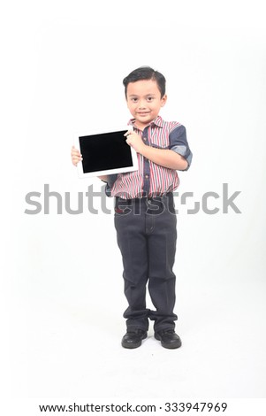 Handsome hipster guy smiles and holds tablet isolated on white background studio portrait