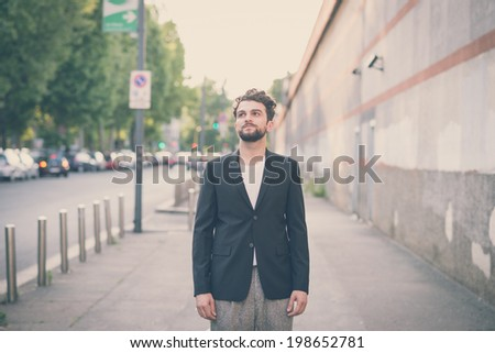 handsome hipster modern man in the city