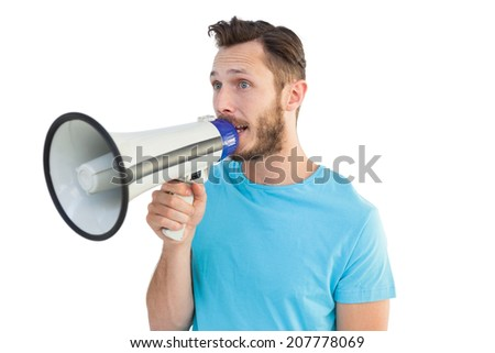 Handsome hipster talking through megaphone on white background