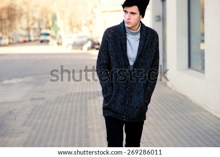 Handsome hipster walking down the street - stock photo