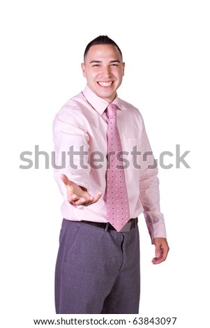 Handsome Hispanic Businessman Extending His Empty Hand for your product - stock photo