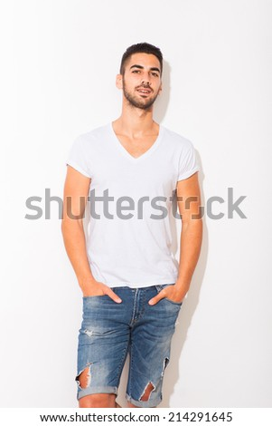 handsome hispanic man in white tshirt, with shadow on white background - stock photo