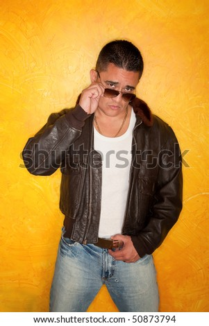 Handsome Hispanic Man Wearing Vintage Pilot Bomber Jacket - stock photo