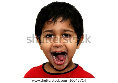 Handsome Indian kid happy after an hearty meal - stock photo