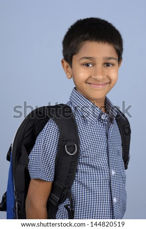 Handsome Indian toddler ready to go to school - stock photo