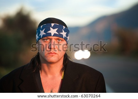 Handsome indigenous man by the side of the road - stock photo