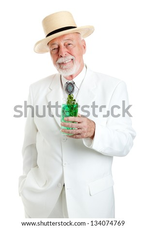 Handsome Kentucky colonel or Southern gentleman drinking a mint julep for Derby Day.  Isolated on white. - stock photo