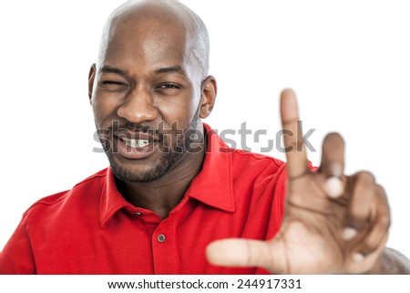 Handsome late 20s black man holding up fingers getting an artist perspective isolated on a white background