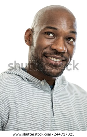 Handsome late 20s black man looking away portrait isolated on a white background - stock photo