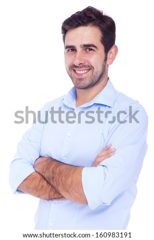 Handsome latin man smiling with arms crossed, isolated over a white background