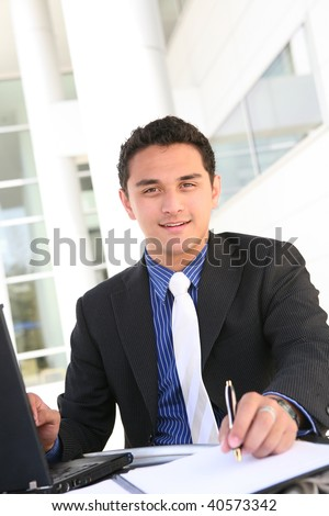 Handsome Latino Business Man at Office Working - stock photo
