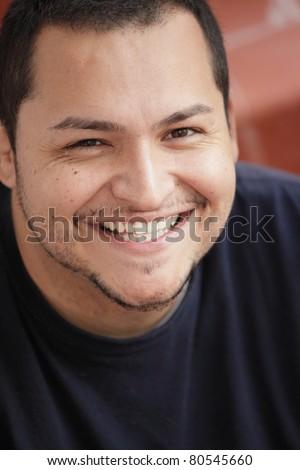 Handsome Latino man smiling - stock photo