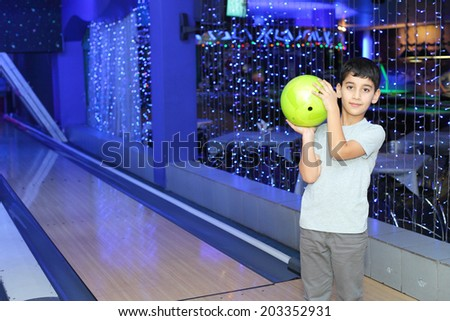 handsome little boy playing bowling - stock photo