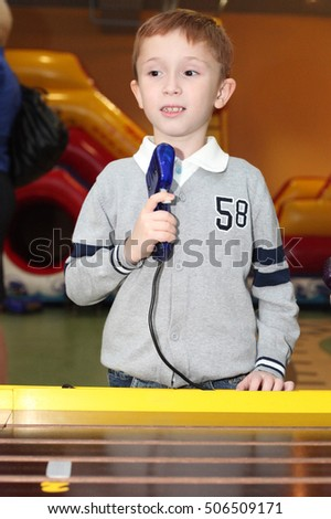 handsome little boy playing on the race