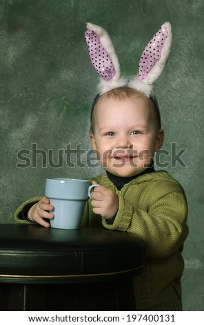 handsome little boy with hare ears studio - stock photo