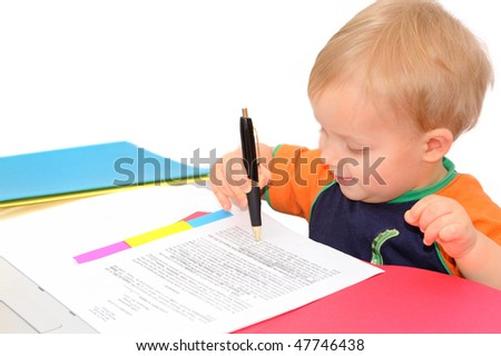 Handsome little businessman is reading a contract - stock photo