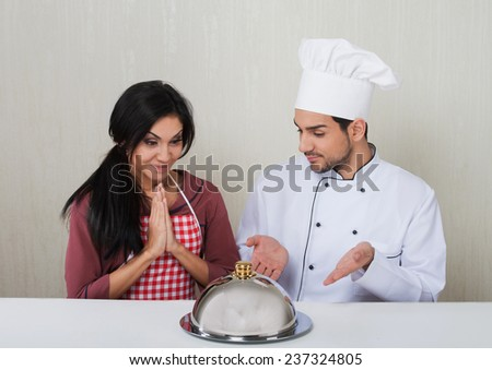 Handsome male chef ?ooked a surprise meal for the girl - stock photo