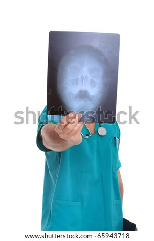 Handsome male doctor looking at xrays over white background