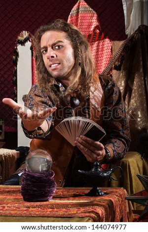 Handsome Male Fortune Teller Tarot Cards Stock Photo ...