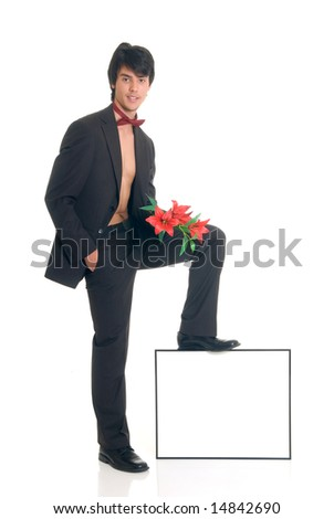 Handsome male gigolo with flower, foot on advertising board,  Studio shot, white background - stock photo