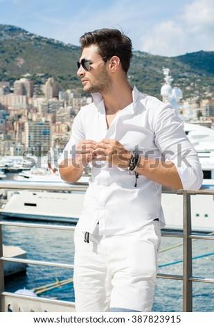 Handsome male model in port - stock photo